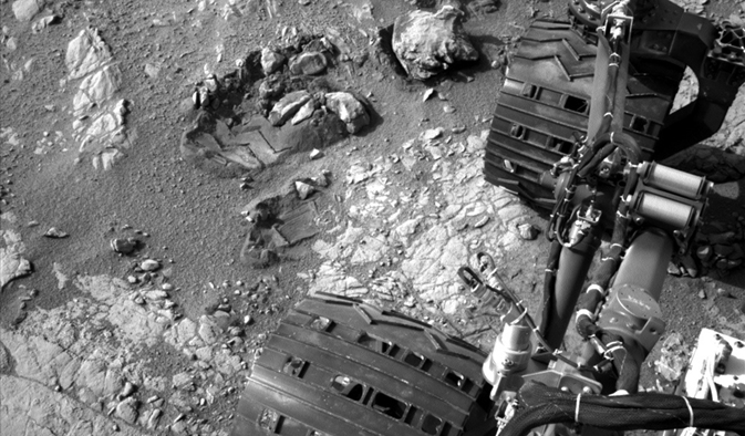 Curiosity's left-front and left-center wheels on Mars