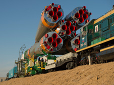 201303260007hq -- The Soyuz rocket is rolled out to the launch pad