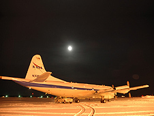 The moon over the NASA P-3B prior to the IceBridge team's 1 a.m. departure from Fairbanks, Alaska, on Mar. 26, 2013.