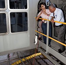 Mary Hanna, of the Vehicle Integration and Launch Branch of Ground Systems Development and Operations Program, describes modifications being made to crawler-transporter-2 to NASA Administrator Charlie Bolden