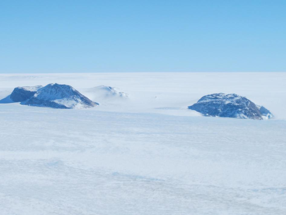 Nunataks, areas of exposed rock, in the western portion of the Greenland ice sheet seen from the NASA P-3B during an IceBridge survey of southwestern Greenland on Apr. 8, 2013.