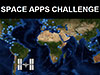 Map of the world with the International Space Station over South America and the words Space Apps Challenge