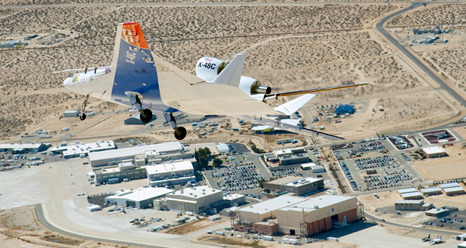 The X-48C Hybrid Wing Body research aircraft banks right over NASA's Dryden Flight Research Center at Edwards Air Force Base during one of the sub-scale aircraft's final test flights on Feb. 28, 2013.