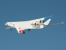 A deep blue sky backdrops the NASA-Boeing X-48C Hybrid Wing Body aircraft as it flies over Edwards AFB on Feb. 28, 2013, during a test flight from NASA's Dryden Flight Research Center, Edwards Calif.