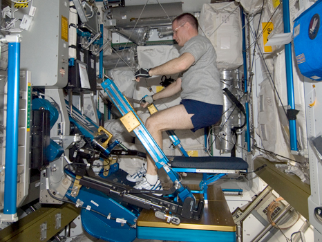 NASA astronaut Kevin Ford, Expedition 34 commander, exercises using the advanced Resistive Exercise Device (aRED) on the International Space Station.
