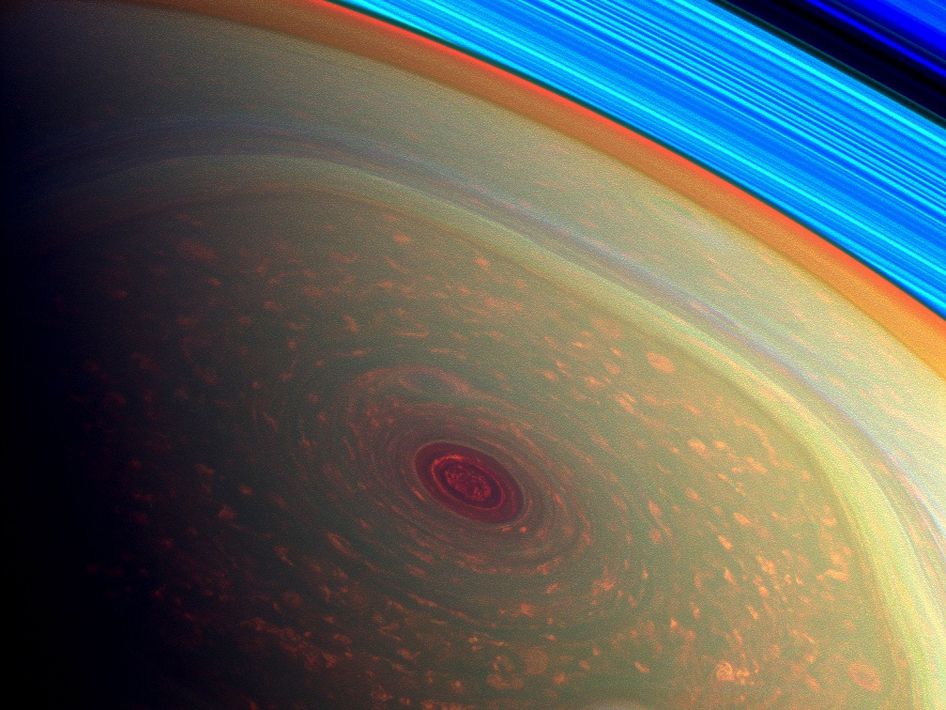 This spectacular, vertigo inducing, false-color image from NASA's Cassini mission highlights the storms at Saturn's north pole