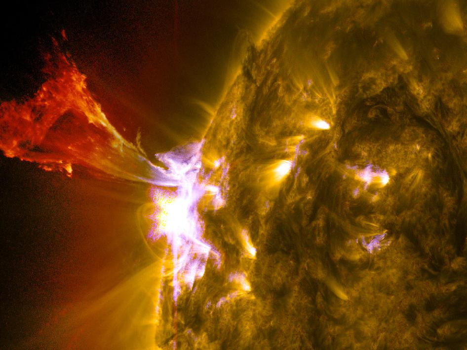 A burst of solar material leaps off the left side of the sun in what's known as a prominence eruption.