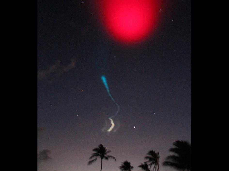 Red and white vapor clouds filled the skies over the Marshall Islands as part of NASA's Equatorial Vortex Experiment (EVEX). The red cloud was formed by the release of lithium vapor and the white tracer clouds were formed by the release of trimethyl aluminum (TMA).