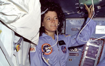 Sally Ride floats alongside Challenger's middeck airlock hatch. Image credit: NASA