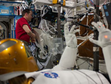 ISS035-E-030804: Astronaut Tom Marshburn and Robonaut