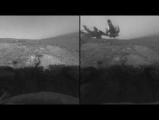 These two images, taken five Martian days (sols) apart by the front hazard-avoidance camera