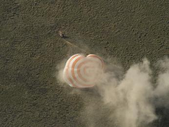 The Soyuz TMA-07M spacecraft is seen as it lands with Expedition 35 Commander Chris Hadfield of the Canadian Space Agency (CSA), NASA Flight Engineer Tom Marshburn and Russian Flight Engineer Roman Romanenko of the Russian Federal Space Agency (Roscosmos).
