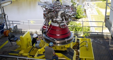 Engineers install J2X engine E10002 in the A1 test stand at Stennis Space Center.
