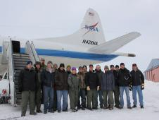 Group photo of IceBridge Arctic 2013 team posing in front of the NASA P-3B.