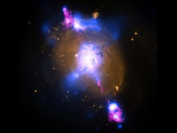 This composite image of a galaxy illustrates how the intense gravity of a supermassive black hole can be tapped to generate immense power.