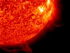 The Sun had plasma sliding along just above its surface and another area close by where plasma rose up and burst into space in less than 12 hours (May 8 - 9, 2013).