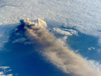 Astronauts aboard the International Space Station (ISS) photographed this striking view of Pavlof Volcano on May 18, 2013. The oblique perspective from the ISS reveals the three dimensional structure of the ash plume, which is often obscured by the top-down view of most remote sensing satellites.