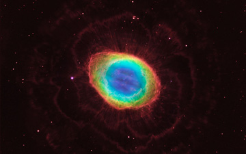 In this composite image, visible-light observations by NASA's Hubble Space Telescope are combined with infrared data from the ground-based Large Binocular Telescope in Arizona to assemble a dramatic view of the well-known Ring Nebula.