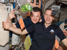 ISS crew with fresh vegetables