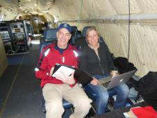 Teachers Mark Buesing and Jette Poulsen aboard the NASA P-3B during an IceBridge survey flight on Apr. 8, 2013.