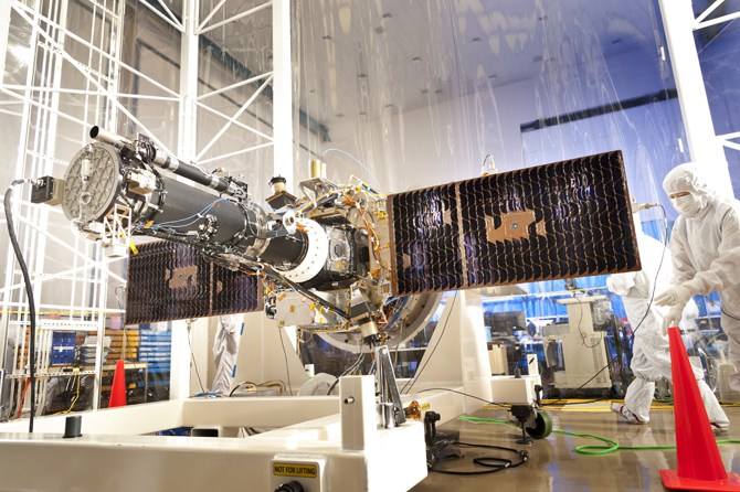 NASA's Interface Region Imaging Spectrograph is shown here in the clean room, with its solar panels extended.