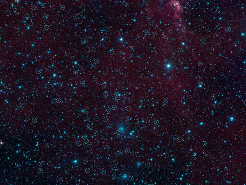 There are nearly 200 galaxies within the marked circles in this image from NASA's Spitzer Space Telescope