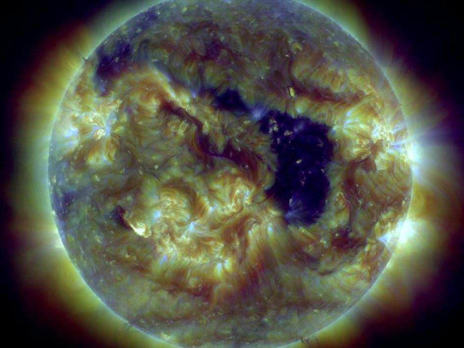 An extensive coronal hole rotated towards Earth over several days this week (May 28-31, 2013).