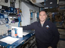 Expedition 34 commander Kevin Ford of NASA with the Capillary Flow Experiment (CFE) Vane Gap 2 test in the Node 2 aboard the International Space Station. (NASA)