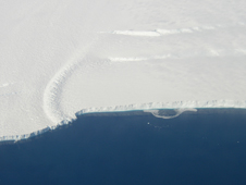 This photo shows the ice front of the ice shelf in front of Pine Island Glacier, a major glacier system of West Antarctica