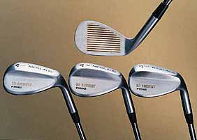 Photo of four golf clubs