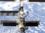 The International Space Station in orbit. The Canadarm2 can be seen near the bottom of the picture.