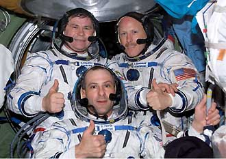 The Expedition Six crewmembers, wearing Russian Sokol suits, pose for a crew photo aboard the International Space Station. Pictured are astronaut Donald R. Pettit (front), NASA science officer; cosmonaut Nikolai M. Budarin (left back), flight engineer; and astronaut Kenneth D. Bowersox, mission commander. Budarin represents Rosaviakosmos.