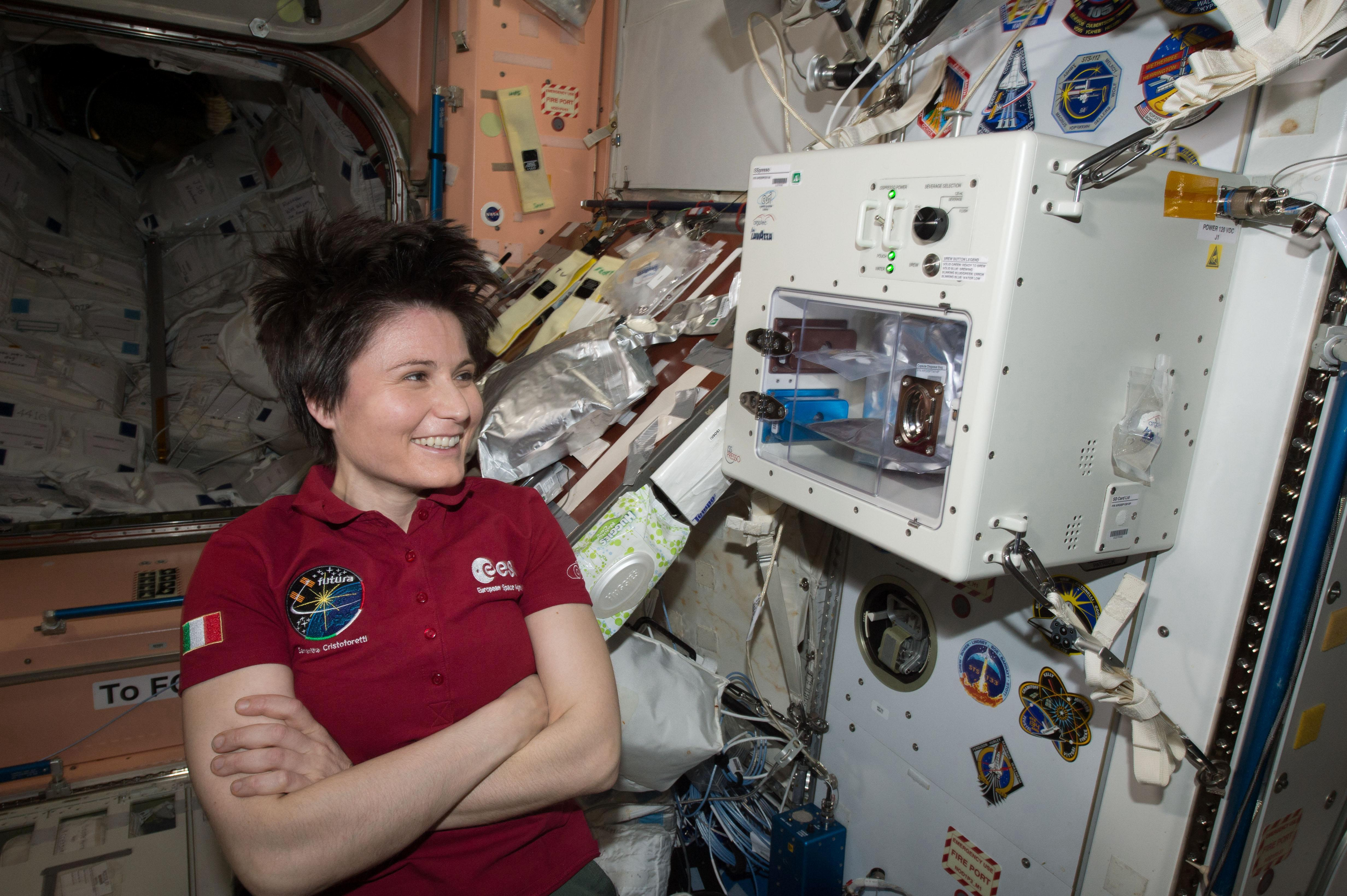 female astronaut drinking water in space - photo #21