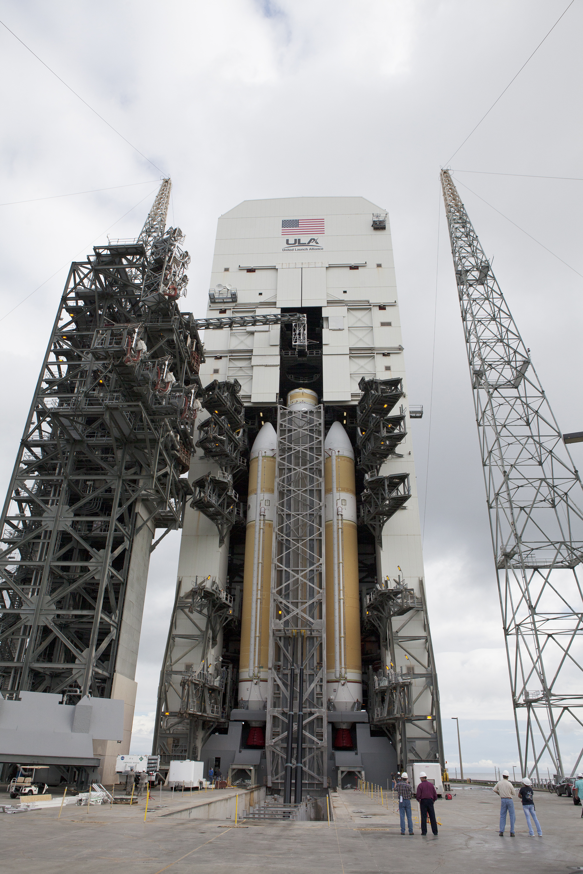 The United Launch Alliance Delta IV Heavy rocket that will send NASA's Orion spacecraft on its first flight test in December was moved to its vertical launch position Oct. 1 at Space Launch Complex 37 at Cape Canaveral Air Force Station in Florida. The rocket is secured on the Elevated Platform Transporter.
