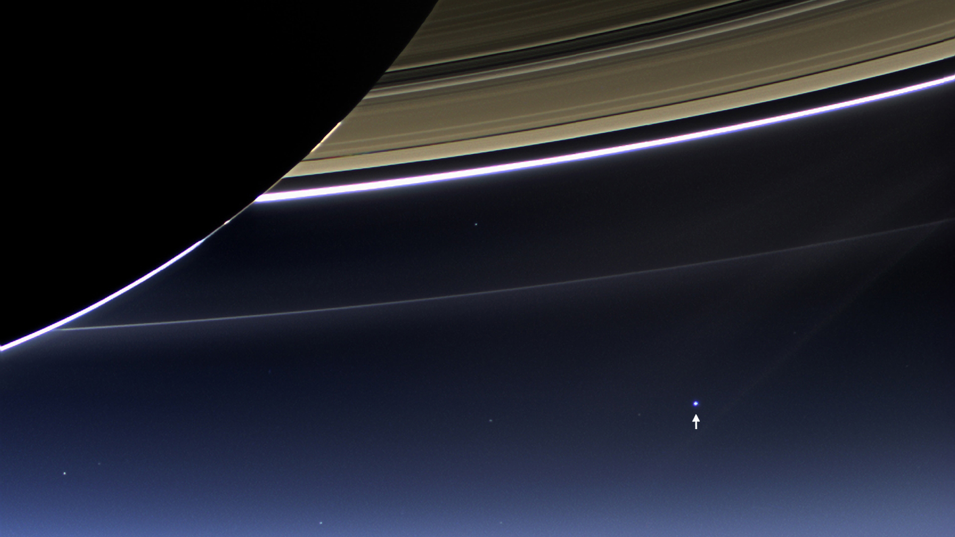 Of planet earth as a point of light between the icy rings of saturn - Saturn S Rings And Our Planet Earth