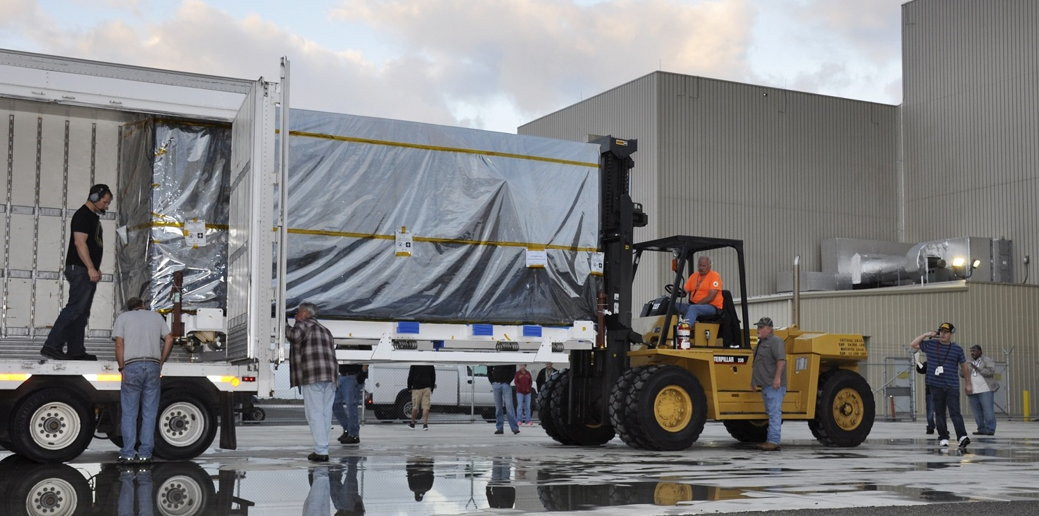 NASA's Soil Moisture Active Passive (SMAP) spacecraft is delivered by truck to the Astrotech payload processing facility at Vandenberg Air Force Base in California on Wednesday, Oct. 15, 2014. Image Credit: NASA