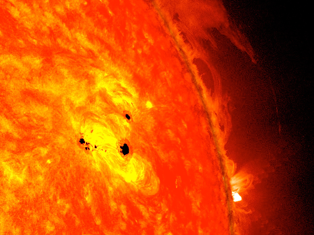 The bottom two black spots on the sun, known as sunspots, appeared quickly over