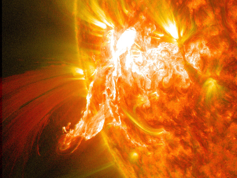 Nasa S Sdo Sees A Solar Flare And A Lunar Transit Nasa