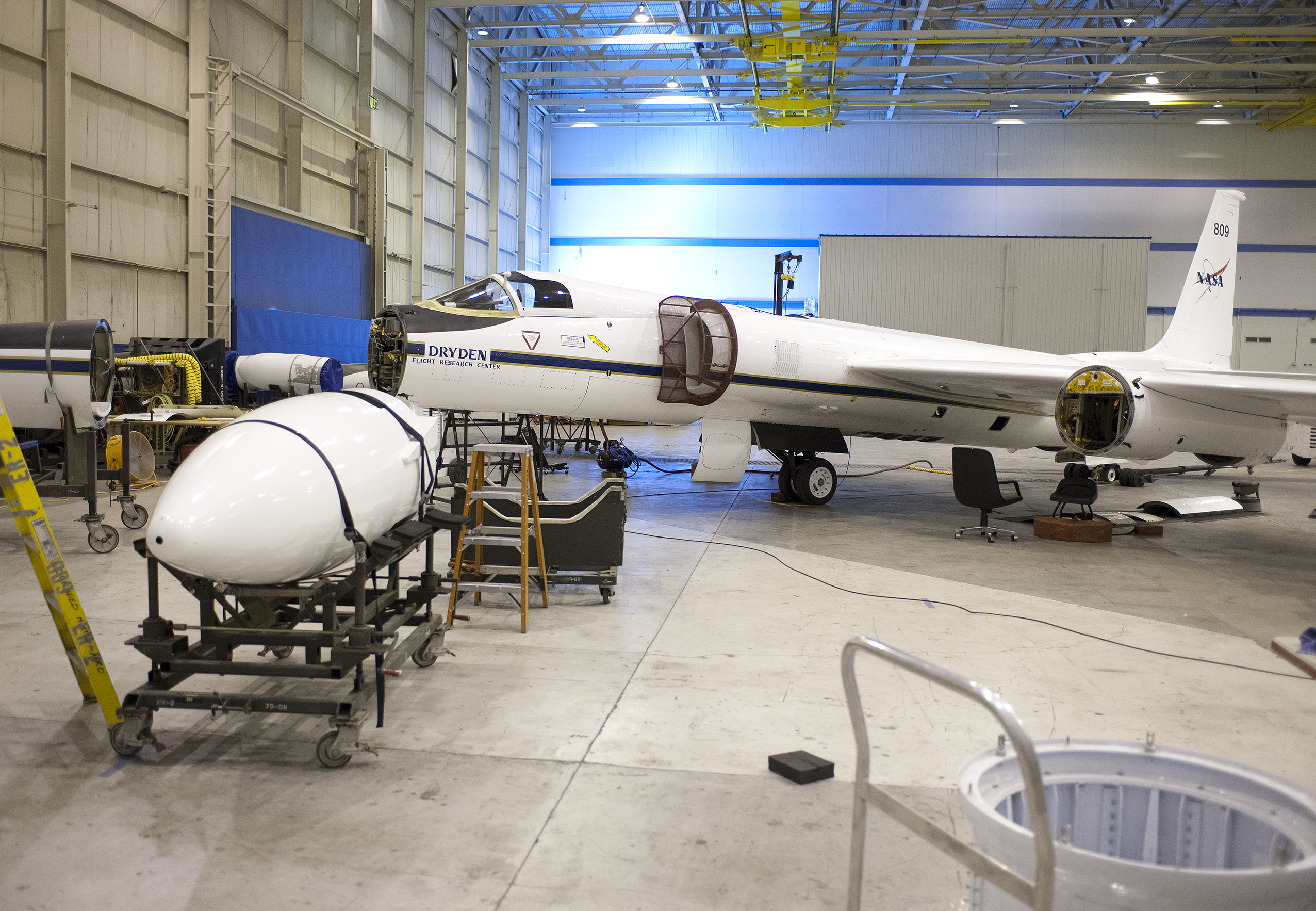 The equipment bays and wing pods of NASA's high-altitude ER-2 will carry 15 specialized instruments to study how the vertical convection of air pollution and natural emissions affect climate change. Image Credit: NASA / Tom Tschida