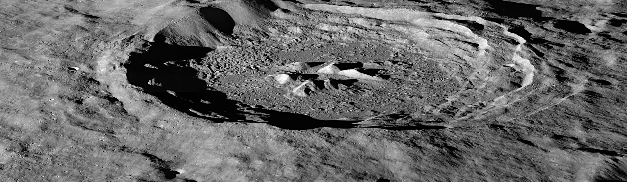 LRO image of the moon's Hayn Crater, located just northeast of Mare Humboldtianum, dramatically illuminated by the low Sun casting long shadows across the crater floor.