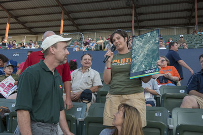 "In the stands at Joe Davis Stadium, Kristin Morgan, right, a strategic analyst in Marshall's Office of Strategic Analysis & Communications, leads a ""Jeopardy""-style trivia challenge, asking the crowd questions about NASA and space exploration."
