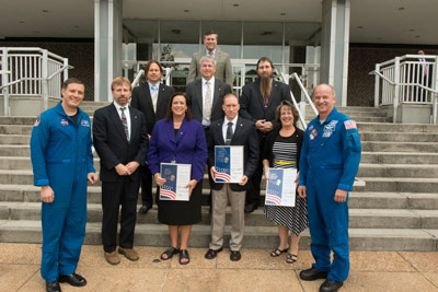 From left, first row, astronaut Jack Fischer; and honorees Kenneth G. Cooper, Propulsion Systems; Angela T. Haddock, Mission Operations Laboratory; Keith Brockway, Communication Services Office; Kathryn Huffman-Graham, Chief Engineers' Office; astronaut Jeff Williams; second row, Robert R. Hickman, Materials & Processes Laboratory; Kenneth Frederick, Space Systems Department; J.R. Booker, Spacecraft & Vehicle Systems Department; third row, Marshall Center Director Patrick Scheuermann.