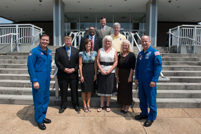 From left, first row, astronaut Jack Fischer; and honorees Jason Turpin, Space Systems Department; Mardi M. Wilkerson, Mission Operations Laboratory; Andrea E. Nunn, Office of the Chief Information Officer; Linda S. Southworth, Office of Strategic Analysis & Communications; astronaut Jeff Williams; second row, Vinay Patel, Applications Architecture & Strategy Office; Randal McNichol, Space Systems Department; third row, Marshall Center Director Patrick Scheuermann.
