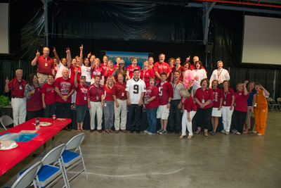 "Marshall Center Director Patrick Scheuermann, center, sporting the ""9"" jersey, joins 40 proud Alabama fans at the 2013 Team Pride Social and Dip Challenge on Aug. 29."
