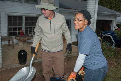 T.K. Pendergrass, a resource team lead, left, and Beverly Reynolds, a program analyst, both in the Marshall Center's Spacecraft & Vehicle Systems Department, help clear brush and fallen leaves at the home of a senior citizen as part of a CFC Community Service Day with Friends, Inc.