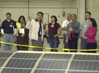 With a solar cell-covered wing section in the foreground, NASA Dryden solar aircraft project manager