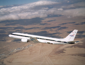 NASA's Airborne Science Dc-8, displaying new colors in a check flight Feb. 34, 2004 over the Dryden Flight Research Center.
