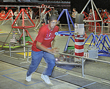 The 'runner' for the Mojave High School Robotics team sprints back for another plastic gamepiece.