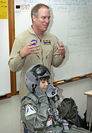 Sixth-grade student Leo Banuelos learned first-hand about the gear photographer Jim Ross wears in the cockpit.
