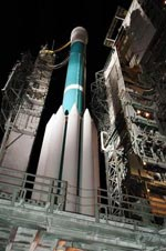 A Delta II rocket sits on the launch pad.
